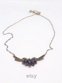 Sterling silver and marcasite necklace set with pear shaped amethysts.