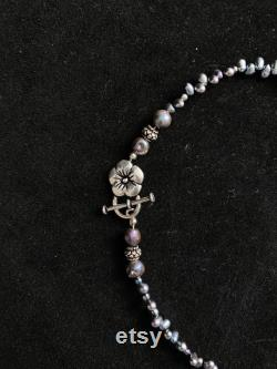 Stunning peacock pearl statement necklace with gorgeous baroque pearl pendant and amethyst and sterling silver accent beads.